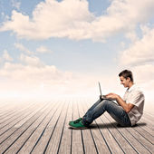 Young man using a laptop — Foto Stock