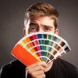 Man holding a pantone — Stock Photo #37221065