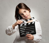 Little girl holding a movie clapper board — Stock Photo