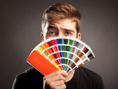 Man holding a pantone — Stock Photo