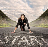 Businesswoman on a road ready to run — Stock Photo