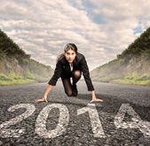 Businesswoman ready to start year 2014 — Stock Photo