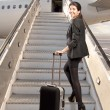 Businesswoman before boarding — Stock Photo
