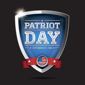 Patriot day september 11, 2001 on shield — Stock Vector