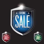 Seasonal sale shield set - red, blue, green — Stock Vector