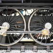 Stock Photo: Grunge old steam locomotive wheel and rods