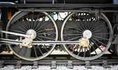 Grunge old steam locomotive wheel and rods — Stock Photo