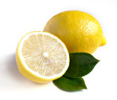 Lemon with leaves on white — Stock Photo