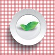 White plate on a checkered tablecloth — Stock Vector