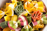 Multicolored italian pasta, horizontal background — Stock Photo