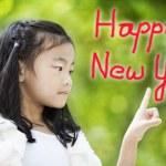 Little girl brush stroke happy new year — Stock Photo #16736259