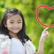 Little girl write the heart by hand — Stock Photo