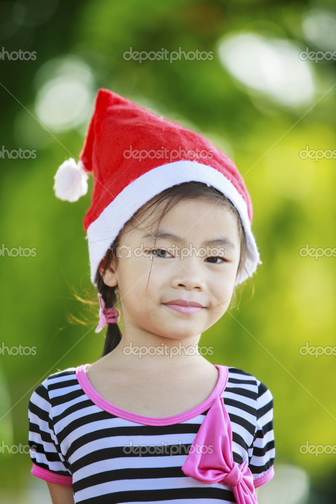Asian kid with santa had. — Stock Photo #16761279