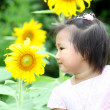 Royalty-Free Stock Photo: Beautiful child with sunflower