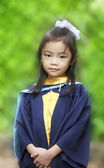 Achievement of degree for young babay in the green nature. — Stock Photo