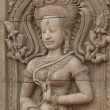 Apsara sculptures at Angkor Wat - Stock Photo