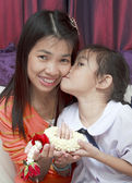 Baby give flower to her mom — Stock Photo