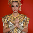 Portrait of Thai young lady in an ancient Thailand dance - Stock Photo