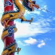 Giant golden Chinese dragon - Stock Photo