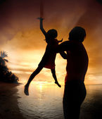 Silhouette family of child hold on father hand — Stock Photo