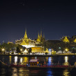 Stock Photo: Thai's king palace with goldent guard ship