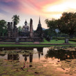 Main buddha Statue in Sukhothai historical park - Stock Photo