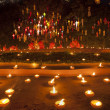New year festival, Buddhist monk fire candles to the Buddha on J - Stock Photo