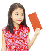 Asian girl holding red packet,chinese new year theme — Stock Photo