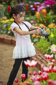 Unidentify girl take a flower photo — Stock Photo