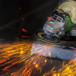 Grinding in a steel factory - Stock Photo