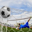 Soccer ball in goal — ストック写真
