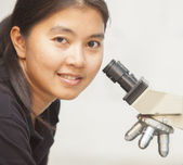 Scientist using a microscope — Stock Photo