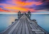 Wooded bridge in the port between sunrise — Stock Photo