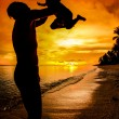 Silhouette family of child hold on father hand — Stock Photo #26799315