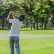 Stock Photo: Male golf player teeing-off golf ball