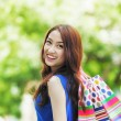 Smiling girl with shopping bags — ストック写真