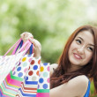 Stock Photo: Smiling girl with shopping bags