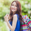 Stock Photo: Girl with shopping bags