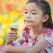 Asian kid with ice cream — Stock Photo