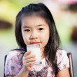 Asian girl drink milk — Stock Photo