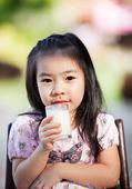 Asian girl drink milk — Stock Photo