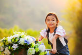Happy asian girl on bicycles — Stock Photo