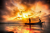 Fisherman of Bangpra Lake in action when fishing — Stock Photo