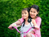 Mother and chikd with bicycle — Stock Photo