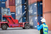 Foreman control forklift handling the container box  — Stock Photo