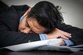 Tired overworked businessman sleeps — Stock Photo