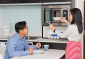 Kitchen room with asian family — Stock Photo