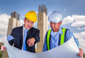 Asian engineer and worker leader discus for drawing detail — Stock Photo