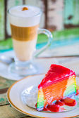 Layer rainbow cakes and cappuccino coffee — Stock Photo