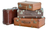 Pile of old vintage suitcases — Stock Photo
